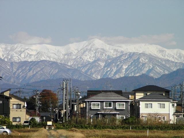 Snow covered Iide mountain in November, view from Akiha-ward Niigata-shi
